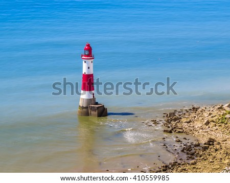 Beachy Head Lighthouse near Eastbourne coast by sunny day, Eastbourne, East Sussex, England - stock photo