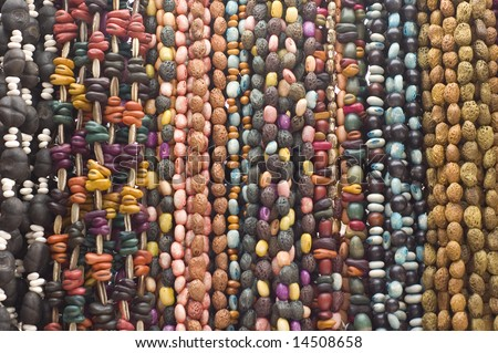 Bead necklaces hanging for sale in a market in Mexico - stock photo
