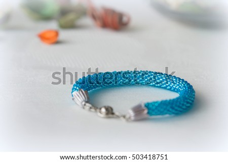 Beaded crochet bracelet made of beads turquoise color