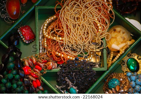 Beads, brooches, rings, earrings and other bijouterie in box - stock photo