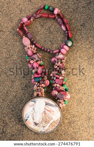 Beads from natural stones on asphalt. Top view - stock photo