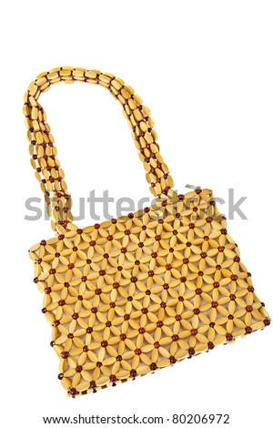 Beads handbag made from wood isolated on white background - stock photo