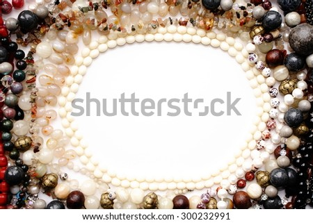 Beads in circle. Beads photo frame, background for text and design. View from above. - stock photo