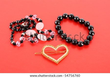 beads on red background - stock photo