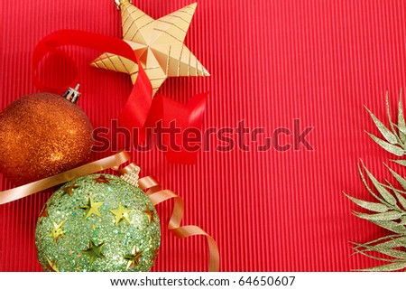 Beads, ribbons and Christmas stars over red background. - stock photo