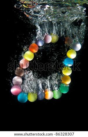 Beads under water. Close up. Macro shot. - stock photo