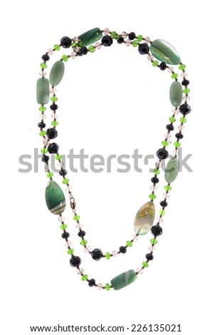 Beads with green stones on white on white background - stock photo