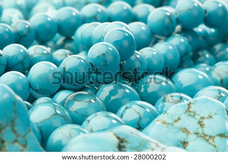 beads with natural stone turquoise close-up background   - stock photo