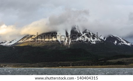 Beagle channel mountains over the Ocean - stock photo