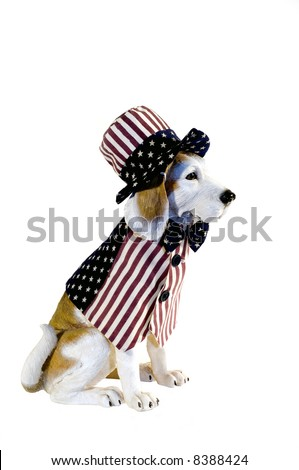 Beagle dog statue, dressed in patriotic red, white, blue vest and hat - stock photo