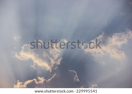 Beam of sunlight through clouds background. - stock photo