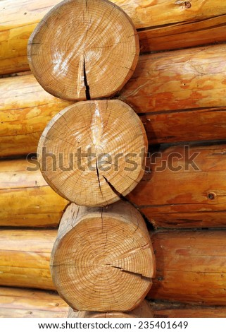 beams in section on wooden lodge, you can see the annual growing circles, spruce wood - stock photo