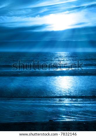 Beams of Light on a Blue Ocean Sunset - stock photo
