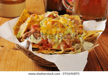 Bean and cheese nachos on black bean corn chips - stock photo