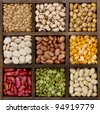 Bean background nine varieties in a printers box, pinto, lima, navy, black eyed, spit peas, soy, lentils, - stock photo