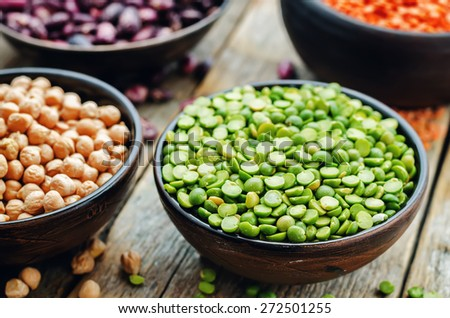 bean. green and yellow peas, colored beans, chickpeas, green and red lentils. the toning. selective focus - stock photo