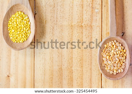 Bean on wooden spoons - stock photo