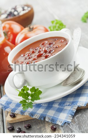 Bean soup with tomato and peppers on the table