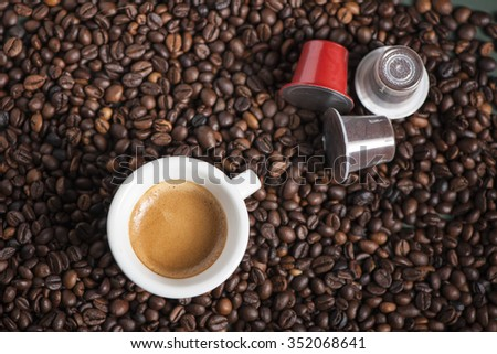 beans and coffee pods - stock photo