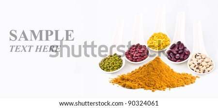 Beans and curry powder with sample text isolated on white background. - stock photo