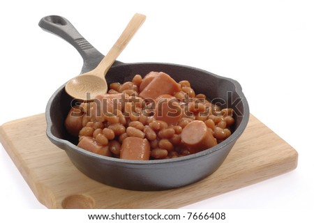 Beans and wieners in a cast iron skillet.