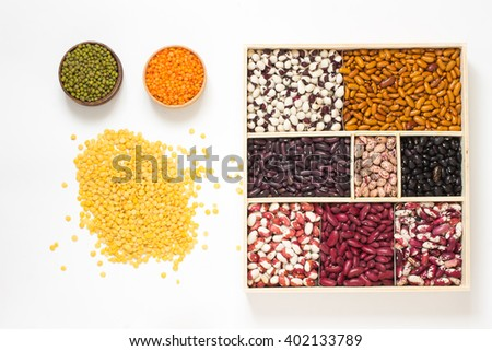 Beans of different colors. lentils in a wooden bowl. Top view