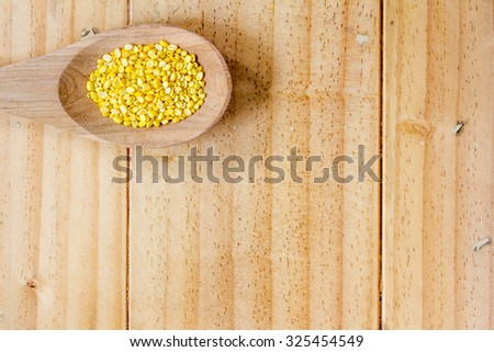 Beans on wooden spoon - stock photo