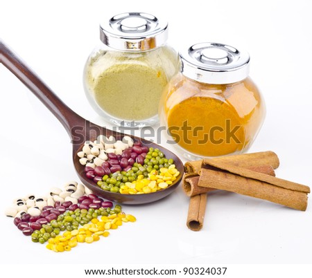Beans, spices and curry powder in the bottle isolated on white background. - stock photo