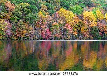 Bear Mountain with Hudson River in Autumn with colorful foliage and water reflection. - stock photo