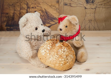 bear toy with bread on wood
