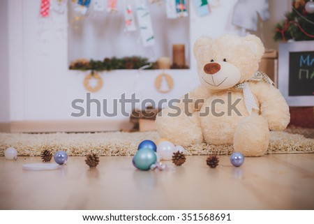 Bear with Christmas gift boxes and toys