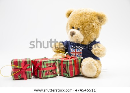 Bear with Christmas present on white background