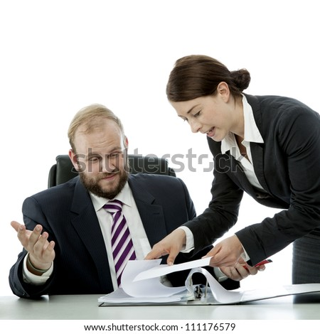 beard business man brunette woman at desk confusing