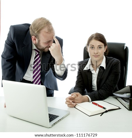 beard business man brunette woman at desk employee is stupid