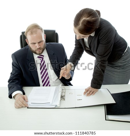 beard business man brunette woman at desk show documents