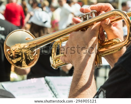 Beard Man Playng Brass Lacquered Trumpet during Outdoor Concert - stock photo