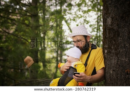 bearded dad walking with babies - stock photo