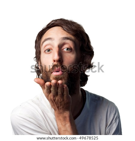 Bearded guy blows a kiss - stock photo