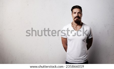 Bearded handsome guy in blank t-shirt