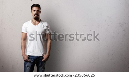 Bearded handsome guy in white t-shirt - stock photo