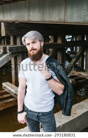 Bearded hipster with nose ring outdoor street
