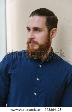 Bearded hipster with piercing in the city outdoor