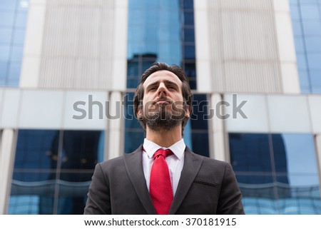 Bearded man dressed with a suit in the street