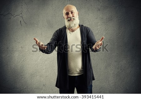 bearded man friendly pulling hand to the camera over dark background - stock photo