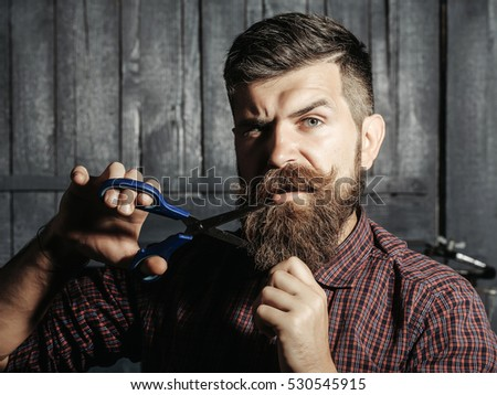 How To Trim Mens Long Hair With Scissors : Man hair stylist is cutting short of a young man. stock
