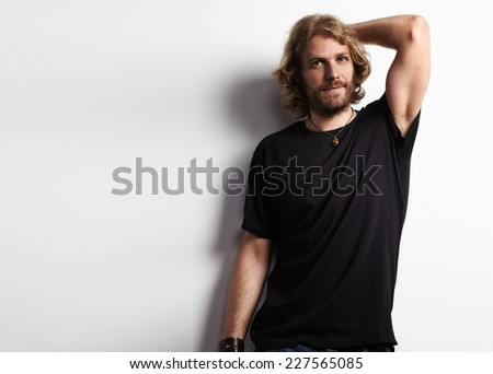 bearded man in a black t-shirt - stock photo