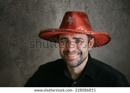 Bearded man in a party cowboy hat - stock photo