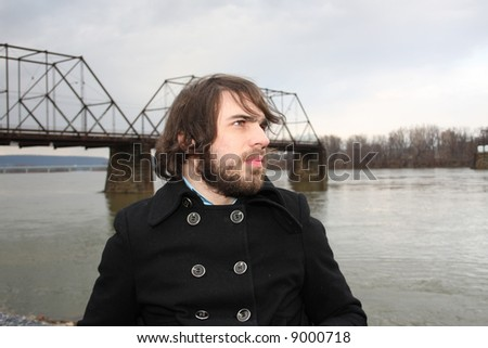 Bearded man in front of river.  Shot in Harrisburg, PA. - stock photo