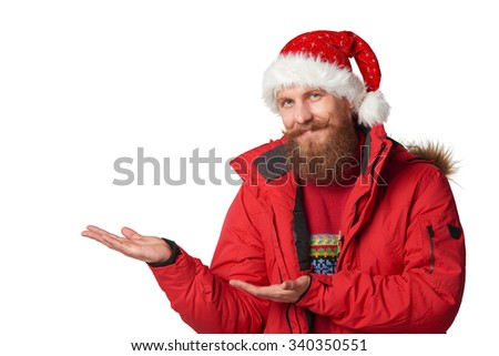 Bearded man in red winter jacket and christmas hat showing open hand palm with copy space for product or text, over white - stock photo
