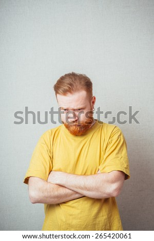 bearded man offended and folded his hands - stock photo